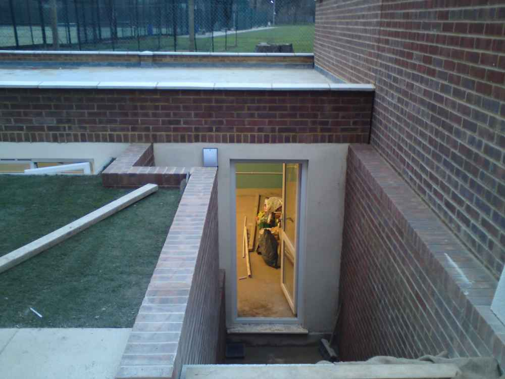 Underground garden basement specialists in london and kent for How to build a house with a basement